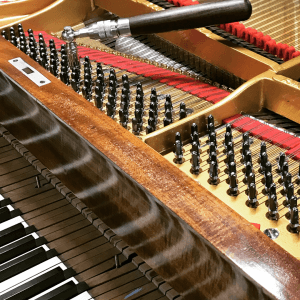 An Image Of Tuning A Grand Piano Put On By Emrich Piano Service